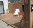 Terrasse et clôture finition bois brut